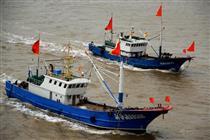 东海伏季休渔结束 现千帆竞渡壮观场面-石浦渔港的渔船出港开赴渔场